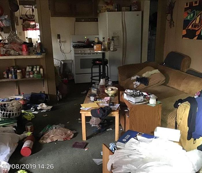 Room with a lots of trash on the floor
